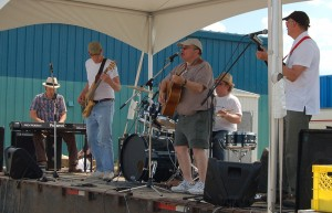 Local band Frozen Toad play at the Hay Days festival on Saturday, June 22, on a stage set up behind the arena. From left, Simon Lepage, Ton Karp, Chris Philpotts, Peter Magill, and Tyler Hawkins put on a good show of Northern-inspired, country music. Photo by Sarah Ladik NNSL