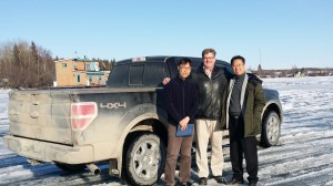 photo courtesy of Brad Mapes Kye Han Lee, left, Brad Mapes, and Suk Lee take a tour out on the ice of the bay on a break from negotiations in Yellowknife last week. Lee and Lee represent the South Korean Hyosung Corporation which is considering purchasing a large amount of wood pellets produced from NWT-based Aurora Wood Pellets.
