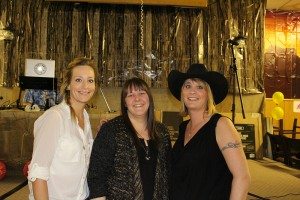 Nikki Ashton, left, Janie Hunt, and Angela Carter were part of the team that put together this year's Playschool Talent Auction last weekend to raise funds for the Playschool. Photo by Sarah Ladik NNSL