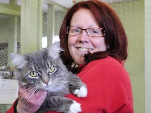 Shelter worker Christine Brassington shows off Johnny Cash, a new arrival at the Hay River SPCA who is still looking for a home. Photo by Sarah Ladik NNSL
