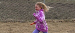Kiera Coakwell runs with a baton for relay practice in preparation for the NWT Track and Field Championships next month.  Photo by Sarah Ladik NNSL
