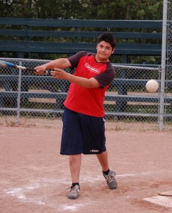 Luke Daigneault (left) and Jordan Smith practise at the Pine Point Ball Diamond on July 4 before leaving for the International Fastpitch Championships in Saskatoon on July 9. Photo by Sarah Ladik NNSL