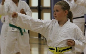 Victoria Tweedie-Pitre gives it her all at last Friday's karate clinic. Photo by Sarah Ladik NNSL