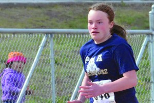 Princess Alexandra student Madison McPhee sprints down the track at the NWT Track and Field Championships last week, ultimatley taking second place overall for the Bantam girls division. She said making the decision to train with Joe LeBlanc at Diamond Jenness Secondary School was a tough one, but that it paid off. Photo by James McCarthy NNSL