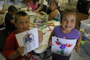 Bert Buckley, left, and Ava Walsh show off their colouring projects at the Soaring Eagle Friendship Centre's Aboriginal Day celebrations June 21.