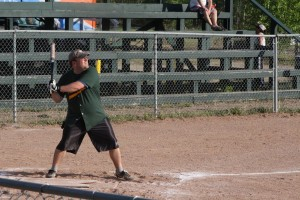Scott Clouthier steps up to bat at a slo-pitch game at the Pine Point Ball Diamond June 18.
