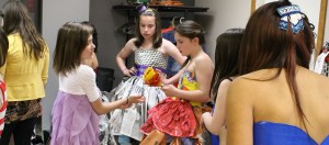 The girls get ready for the show backstage at the Catholic church basement May 22. Photo by Sarah Ladik NNSL