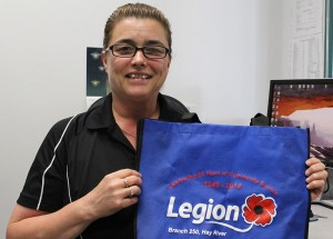 Tracy Cross Gauthier, district commander for the region, shows off a promotional bag made for the Hay River Legion's 65th anniversary. The bags will be handed out for the duration of July. Photo by Sarah Ladik NNSL