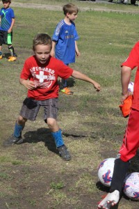 Jacob Aylward chases his ball in a drill last Friday morning at the Challenger Soccer Camp. Sarah Ladik/NNSL photo
