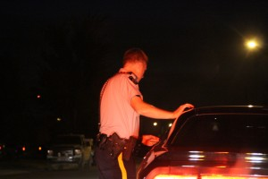 Cpl. Greg Morrow conducts a traffic stop last Friday night. While the first night of the long weekend was a quiet one, the following night-shift was much busier – and more typical for season. -- Sarah Ladik/NNSL photo