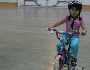 Molly Taylor goes for a ride around the arena ice surface at a Growing Together playgroup August 7. Sarah Ladik NNSL