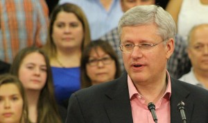 Sarah Ladik/NNSL photo Prime Minister Stephen Harper speaks to a packed gymnasium at Joseph Burr Tyrell School in Fort Smith August 22.