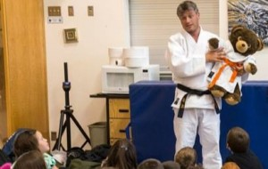 Photo courtesy of Phil Beaupre Nicolas Messner, head of Judo For Peace, talks to students at Ecole Boreale last Monday.