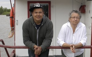 Randy Ross Jr., left, stands next to Beatrice Lepine, who won a territorial writing prize.