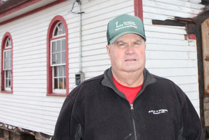 Scotty Edgerton CEO of K'atlodeeche First Nation Standing next to St. Anne's Roman Catholic Church To be moved sideways to new foundation Oct. 14, 2014 Hay River Reserve Photo by Paul Bickford Northern News Services Ltd.