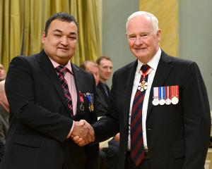 Hay River resident receives Medal of Bravery Mike Sharpe, left, of Hay River Governor General David Johnston October 21, 2014 Ottawa, Ont. Photo courtesy of the Office of the Secretary of the Governor General/Photo by Sgt. Ronald Duchesne