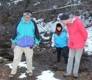 Checking for prehistoric tracks in Escarpment Creek Left to right: Bruce Green April Glaicar Donald Henderson, curator of dinosaurs from Royal Tyrrell Museum in Drumheller, Alta. Oct. 23, 2014 Enterprise Photo by Paul Bickford Northern News Services Ltd.