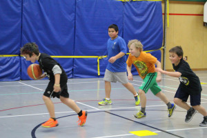 Sarah Ladik/NNSL photo Conner McKay-Ivanko, left, travels up the court pursued by Alan Gostick, Spencer Tweedie-Pitre, and Landon Bowker at last week's basketball practice.