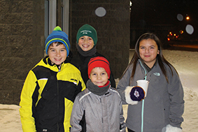 Sarah Ladik/NNSL photo Conner McKay Ivanko, left, Landon Bowker, Everett Durocher, and Ceaira McKay get ready for a night of Christmas fun after the parade Friday night.