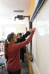 Sarah Ladik/NNSL photo Jennifer Saffrey joins in the actitivity to pick the top three priorities for the newly revamoed community education plan for Diamond Jenness Secondary School Nov. 28.
