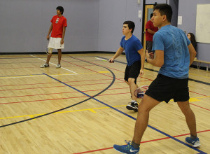 Sarah Ladik/NNSL photo Elliot Pinto, center, and Daniel Melancon get into the action at last weekend's badminton tournament at Diamond Jenness Secondary School.