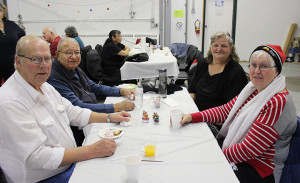 Sarah Ladik/NNSL photo John Peterson, left, Fredrick Beaulieu, Wanda Beaulieu, and Amy Mercredi enjoy last week's buffet lunch put on for community elders at the Soaring Eagle Friendship Centre.