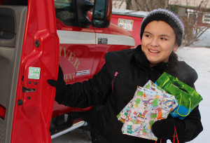 Sarah Ladik/NNSL photo Ceaira McKay hops out of a Hay River Fire Department vehicle last Saturday  during to annual RCMP toy drive.