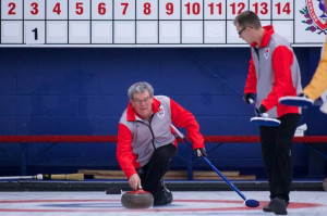 Photo courtesy of Gord Fraser Skip Paul Delorey, left, throws a rock while second Derek Bednarek looks on at the Travelers Curling Championship in Halifax last month.