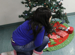 Madison Mandeville chooses which present she wants from under the tree at last week's PHAB Christmas party.  Sarah Ladik NNSL