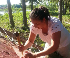 Photo courtesy of Liz Pope Liz Pope works on a hide at Aboroginal Day festivities on the Hay River Reserve two years ago.