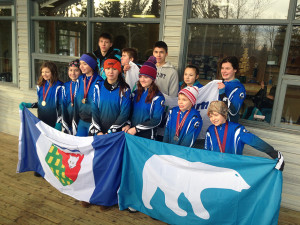 Photo courtesy of Lorraine McDonald Biathletes from Fort Smith and Hay River travelled to Grande Prairie earlier this month to represent team NWT. Front row: Tenielle Patterson,left, Danika Burke, Bronwyn Rutherford - Simon, Callista Burke, Deanna Darosa, Gaius Crook and Seth Patterson.  Back row: Kjel Crook, Andrew Lirette, Clell Crook, Davida Patterson and Elli Cunningham.