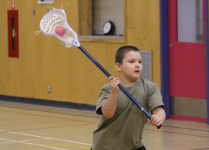 Sarah Ladik/NNSL photo Albert Jensen tries his hand at shooting the ball during a lacrosse workshop at Chief Sunrise Learning Centre last week.
