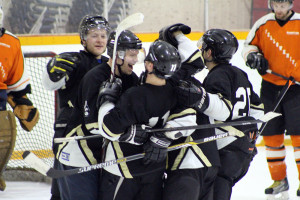 Sarah Ladik/NNSL photo Richard Therrien, , left, Curtis Rowe, J.F. Sylvestre, and Stephane Millette celebrate after a goal scored against Yellowknife on Sunday afternoon.