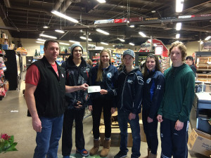 Photo courtesy of Tracy Hill Super A owner John Hill, left, presents a cheque to Tanner Mandeville, Bryn Hill, Dawson McMeekin, Cassidy Ring, and Lochlan Munro before their departure for Prince George, BC, and the Canada Winter Games.