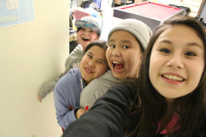Sarah Ladik/NNSL photo Allora Cayen, left, Bianca Sabourin, Destiny Smallgeese, and Faith Martel goof off for the camera last Wednesday at the KFN youth centre. The girls were only some of about 20 children who came out for the evening.