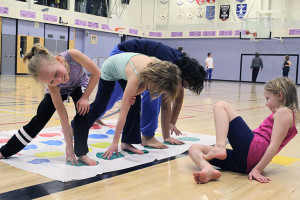 Sarah Ladik/NNSL photo Teegan Brockway, left, Tyler Brockway, Cara Abraham, and Payton Walters play twister at a training session for swim club members in the Diamond Jenness Secondary School gym last Saturday.