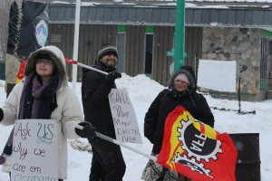 Sarah Ladik/NNSL photo Heather Tybring, left, Craig Edwards, and Jessica Mandeville picket in front of the fire hall last Thursday afternoon.