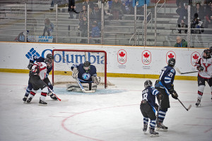 Photo courtesy of the Canada Winter Games Tanner Mandeville, left, defends against a Yukon player in front of the net and goalie Ethan Carey in a match at the Canada Winter Games last week.