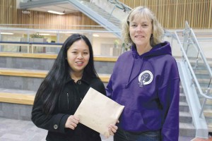 Student Novie Bordey, left, stands with principal Heather Pedjase at Diamond Jenness Secondary School in late 2013. The principal now says she's pleased the GNWT is helping out with $50,000 in funds for the school's youth resiliency programming.