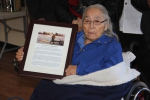 Sarah Lamalice holds a picture of her late husband at the opening of the Jim Lamalice Wilderness Lodge on the Hay River Reserve.
