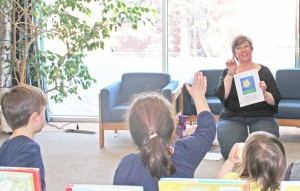Sarah Ladik/NNSL photo Karen Hoose leads a session of Start Your Month Off Right at the NWT Centennial Library last Saturday afternoon.