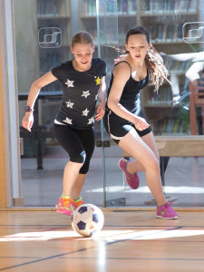 Jared Monkman/NNSl photo Ryann Hendrickson, left, and Sydney Hiebert battle for position during the practice game April 16. April 16, 2015 Hay River PA SChool