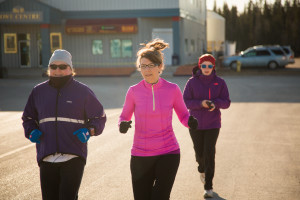 Jared Monkman/NNSL photo Sherry Ringutte, left, Jennifer Touesnard, and Samantha Scheper take their start on a chilly Sunday morning. April 26, 2015 Hay River