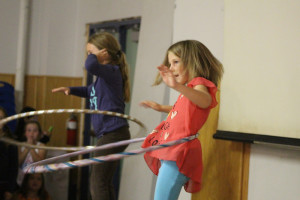 NNSL file photo Jaidyn Henderson, left, and Millie Hunt show off their hula-hooping skills Aug 21 at a talent show put on by Summer Heat last year.