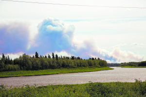 A fire burning across the river from Hay River's Paradise Valley and Patterson Road subdivisions has forced the Hay River Fire Department to Issue a voluntary evacuation notice to residents who live in the area.