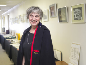 Jared Monkman/NNSL photo Ruth Webb wears her traditional nursing cape, a part of the uniform when she graduated and came to Hay River in 1965, in front of a display of historical hospital memoribilia.   June 27, 2015 Hay River Hospital