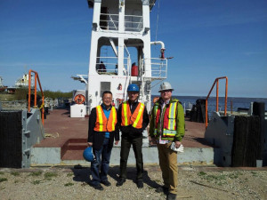 Duncan Dee, adviser to the Canadian Transportation Act Review, left, stands with fellow advisor David Cardin and manager of sales and advertising for NTCL Jevub Wasylyshyn in the Hay River harbour on June 3.