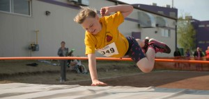 Charlotte Buth takes her last jump at the high jump pit last week for Ecole Boreale.