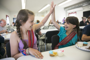 Madison Beck, left, and Emerson Beck share a laugh at the Metis Aboriginal Day festivities.