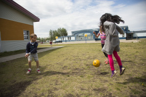 Jared Monkman/NNSL photo Elie Wall, left, and Sophie Brito play at recess at Ecole Boreale, expending energy so they can better concentrate in class.  June 18, 2015 Ecole Boreal